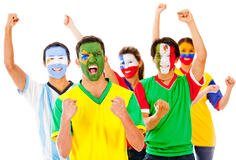 Latinamerican group celebrating with arms up - isolated over a white background